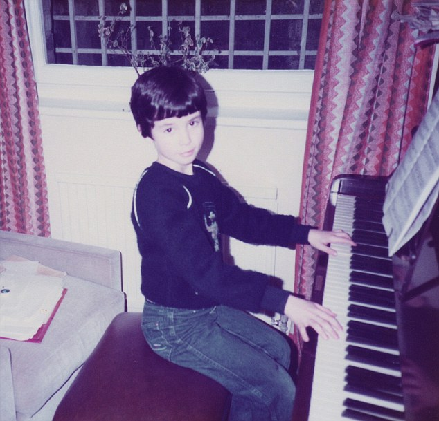 James Rhodes aged about 7 at home  playing the piano ***COLECT PICTURE SUPPLIED BY JAMES RHODES - MAIL ON SUNDAY ONE TIME USE ONLY - MUST CONTACT JAMES BEFORE ANY FUTURE USE - NO SYNDICATION - DO NOT LIBRARY***